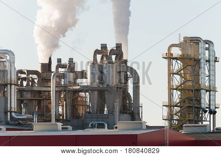 Chemical plant. Silos and smokestacks of a factory.