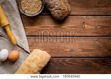 Baking fresh homemade bread on wooden kitchen table background top view moke up