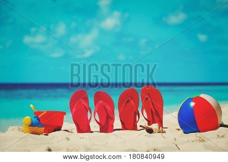 slippers, toys and diving mask at tropical beach