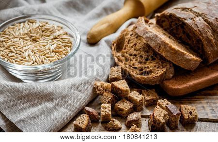 bakery concept with homemade fresh rye bread on rustic kitchen table background