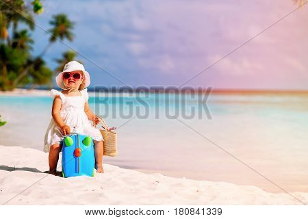 cute little girl travel on summer tropical beach