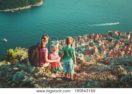 mother with kids looking at old town Dubrovnik, family travel
