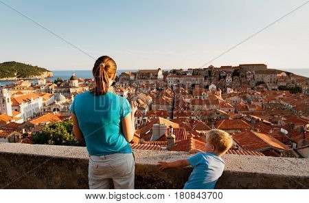 mother with two kids looking at Dubrovnik, Croatia, family travel