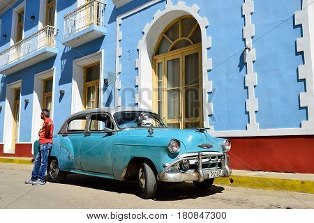 TRINIDAD CUBA - NOVEMBER 08: Old American classical car processed into the taxi for driving tourists all over Cuba on paveed streets on the city of Trinidad on November 08 2016
