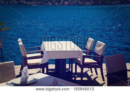 Scenic served cafe table with sea view