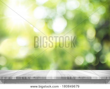 Empty Plank White Wood Table Top With Blur Green Tree Bokeh Background, Template Mock Up For Montage
