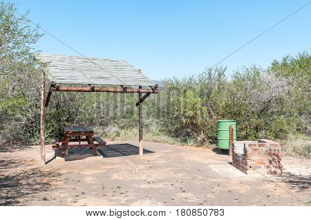 CAMDEBOO NATIONAL PARK SOUTH AFRICA - MARCH 22 2017: A picnic place between Acacia trees in the Camdeboo National Park