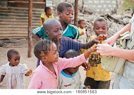 Mombasa. Kenya. January 26, 2012 African children are asking for tourist food