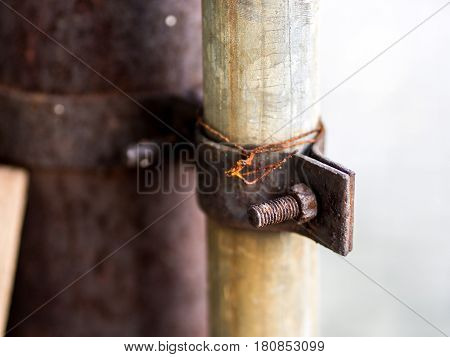 Rusty Bolt and Nut with Wire .