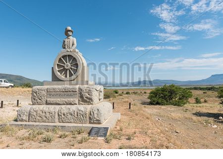 CAMDEBOO NATIONAL PARK SOUTH AFRICA - MARCH 22 2017: The monument in honour of Voortrekker leader Andries Pretorius was inaugurated in November 1943. The Nqweba Dam is visible in the back