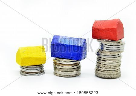 Coins Stacked Up In Piles With Color House