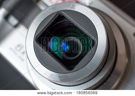 Detail on the Zoom Lens of a Compact Photo Camera. Open Aperture.