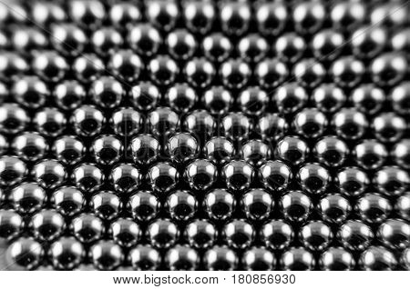 Background from round magnetic metal balls of gray color