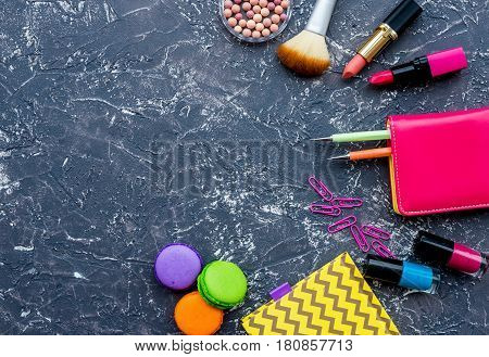 decorative cosmetics on dark background top view.