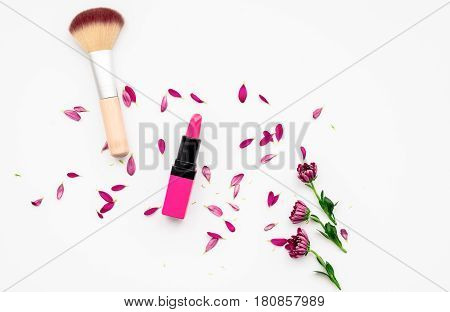 decorative cosmetics on white background top view.