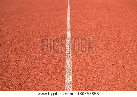 Close up perspective white line of Athletics track in sport stadium
