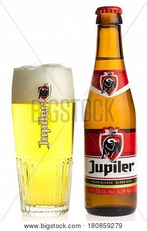 GRONINGEN, NETHERLANDS - APRIL 7, 2017: Bottle and glass of Belgian Jupiler beer isolated on a white background