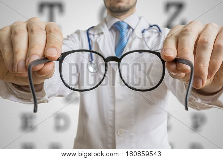 Oculist Doctor Is Offering Glasses To A Patient. Eye Sight Testi