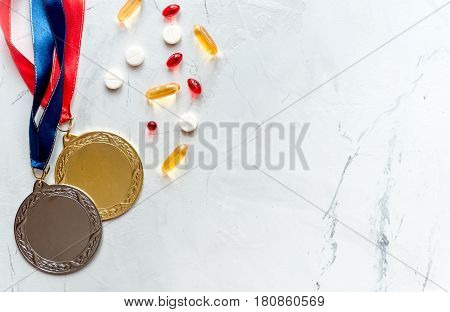 Concept of doping in sport - deprivation medals top view.