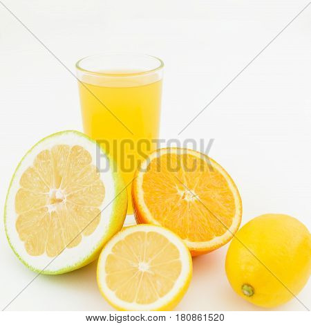 Fresh juice of lemon, orange and sweetie on white background. Flat lay, top view.