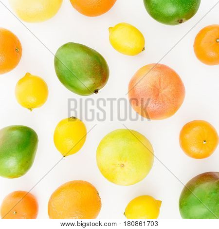 Lemon, orange, grapefruit, sweetie and sweet mangos on white background. Flat lay, top view. Food background