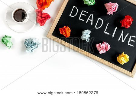 deadline concept on board on white background top view.