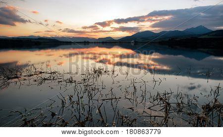 Beautiful nightsky with stars over lake Liptovska mara Slovakia. Hill Choc on backround