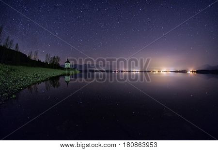 beautiful nightsky with stars over lake Liptovska mara Slovakia