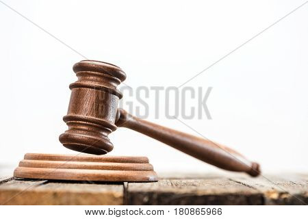 Close-up View Of Brown Wooden Mallet Of Judge On White, Law Concept