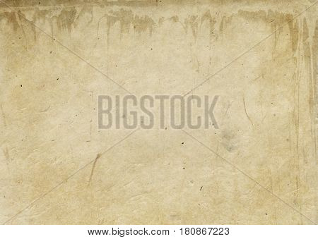 Aged rough paper background or texture for the design. Grunge paper background.