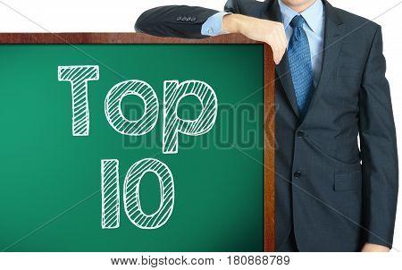 Top 10 On Blackboard Presenting By Businessman