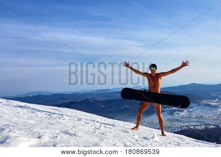 Undressed man standing in the snow. Sheregesh. Winter.