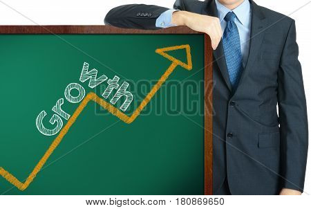 Growth on blackboard presenting by businessman in suit