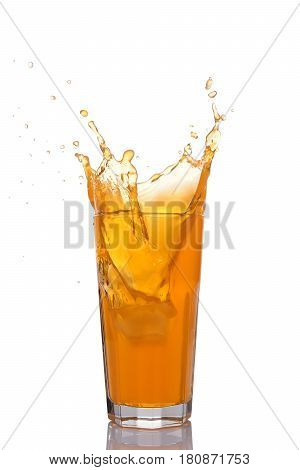 Splash In Glass Of Orange Juice With Ice
