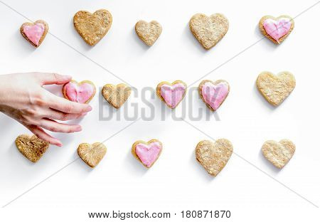 cookies for romantic breakfast heartshaped on white background top view pattern