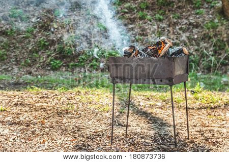 In the brazier burned wood for coals