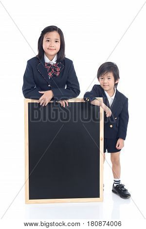 Asian children with black board on white background isolated