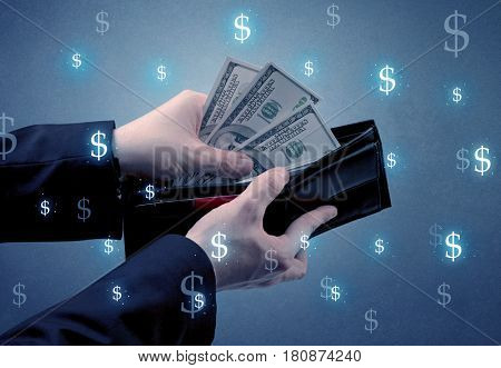 Hand takes out dollar money from a wallet with dollar symbol wallpaper