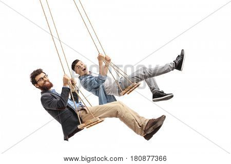Joyful father and son swinging on wooden swings isolated on white background