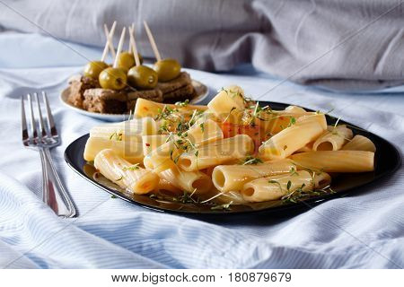 Pasta with watercress and canape with pate and olives