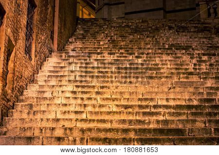 Old stone steps at night in Siena Italy