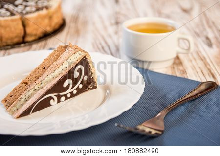 Slice Of Layered Cake With A Cup Of Tea