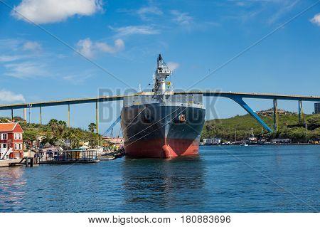 Tanker Moored in Curacao Harbor by Bridge