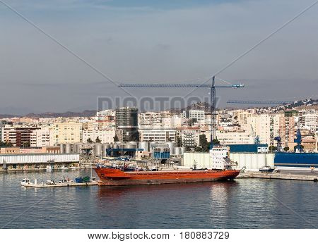 Massive freighter at an industrial dock in Malaga Spain