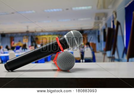 microphone on the table in conference room :Select focus with shallow depth of field.
