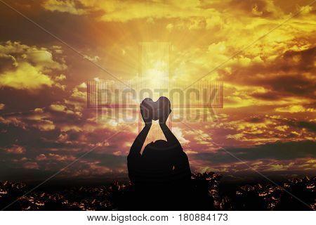 Silhouette Dark Shadow Women Raise Heart Shape On Light From Golden Sky Or Heaven Shine Trough Cruci