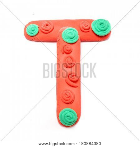 Plasticine letter T. Color plasticine alphabet, isolated.