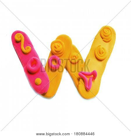 Plasticine letter W. Color plasticine alphabet, isolated.