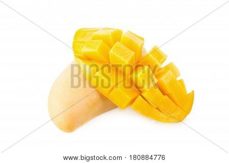 Mango fruit and mango cubes on the white background.