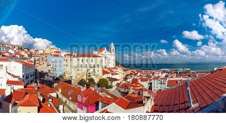 Panoramic view of Alfama, the oldest district of the Old Town, with Igreja de Santo Estevao on the sunny afternoon, Lisbon, Portugal